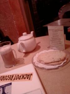Teapot, tea, and crumpets.