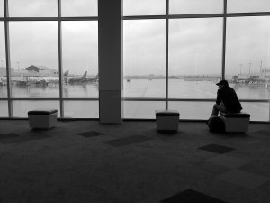 guy alone at the airport terminal