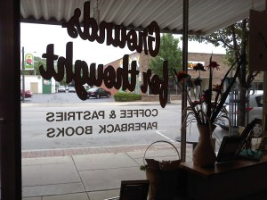 The front window of Grounds for Thought, looking out onto Wooster St.